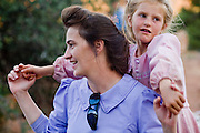 "Aug 9, 2008 -- COLORADO CITY, AZ: A woman and her daughter in Colorado City, AZ. Most of the people who live in Colorado City are members of the FLDS, which practices polygamy. Colorado City and neighboring town of Hildale, UT, are home to the Fundamentalist Church of Jesus Christ of Latter Day Saints (FLDS) which split from the mainstream Church of Jesus Christ of Latter Day Saints (Mormons) after the Mormons banned plural marriage (polygamy) in 1890 so that Utah could gain statehood into the United States. The FLDS Prophet (leader), Warren Jeffs, has been convicted in Utah of ""rape as an accomplice"" for arranging the marriage of teenage girl to her cousin and is currently on trial for similar, those less serious, charges in Arizona. After Texas child protection authorities raided the Yearning for Zion Ranch, (the FLDS compound in Eldorado, TX) many members of the FLDS community in Colorado City/Hildale fear either Arizona or Utah authorities could raid their homes in the same way. Older members of the community still remember the Short Creek Raid of 1953 when Arizona authorities using National Guard troops, raided the community, arresting the men and placing women and children in ""protective"" custody. After two years in foster care, the women and children returned to their homes. After the raid, the FLDS Church eliminated any connection to the ""Short Creek raid"" by renaming their town Colorado City in Arizona and Hildale in Utah. A member of the Jessop family weeds the community corn plot in Colorado City, AZ. The Jessops are a polygamous family and members of the FLDS. Photo by Jack Kurtz / ZUMA Press"