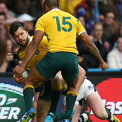 LONDON, ENGLAND - OCTOBER 18: Kurtley Beale of Australia runs to Adam Ashley-Cooper of Australia after his try during the Rugby World Cup Quarter Final match between Australia v Scotland at Twickenham Stadium on October 18, 2015 in London, England. (Photo by Steve Haag)