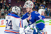 PENTICTON, CANADA - SEPTEMBER 16: Thatcher Demko #35 of Vancouver Canucks congratulates Nick Ellis #34 of the Edmonton Oilers  on the win on September 16, 2016 at the South Okanagan Event Centre in Penticton, British Columbia, Canada.  (Photo by Marissa Baecker/Shoot the Breeze)  *** Local Caption ***  Nick Ellis; Thatcher Demko;