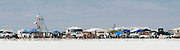 The best cars, people and atmosphere photos of 2009 Speed Week--Heat waves blur fans and their tents, canopies, and RV's as thousands line the 6-mile long track at the Bonneville Speedway in Utah. Photo by Colin E. Braley