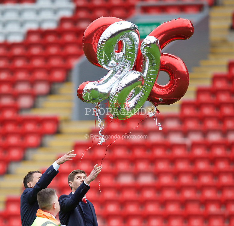 LIVERPOOL, ENGLAND - Wednesday, April 15, 2015: Liverpool's captain Steven Gerrard released two balloons '96' during the 26th Anniversary Hillsborough Service at Anfield. (Pic by David Rawcliffe/Propaganda)