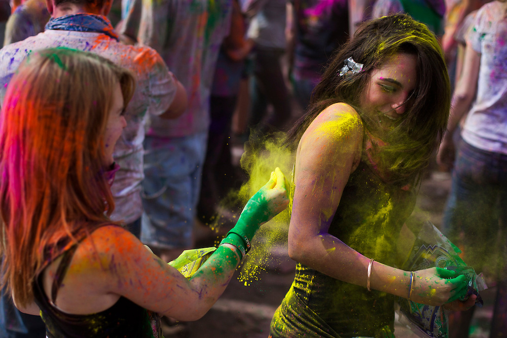 Holi Festival of Colors generates a crowd of all ages at the Lotus Temple, in Spanish Fork, Utah on Saturday, Mar. 24, 2012. Colored powder is thrown in the air and on one another for the Hindu celebration of spring making a beautiful spectacle. (Photo by Benjamin B. Morris ©2012)