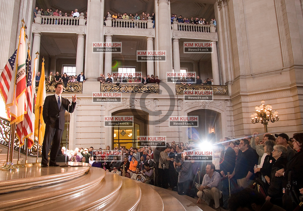 "San Francisco Mayor Gavin Newsom addresses over a thousand gay  couples on the one-year anniversary of San Francisco's same-sex weddings inside City Hall Saturday, Feb. 12, 2005.  Newsom urged gay couples :to hold our elected officials accountable"" for supporting gay marriage.  Photo By Kim Kulish"