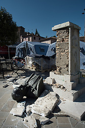 © London News Pictures. 25/08/2016. Amatrice, Italy. A statue is toppled after earthquake damage in the town of Amatrice in central Italy where a 6.2-magnitude earthquake destroyed towns in the area. The death toll is currently at 247 with dozens of people still missing. Thousands of rescuers continue efforts to find survivors. Photo credit: Mario Sabatini/LNP