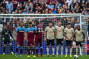 West Ham United FC taking a free kick during the Premier League match between West Ham United and Manchester United at the London Stadium, London, England on 22 September 2019.