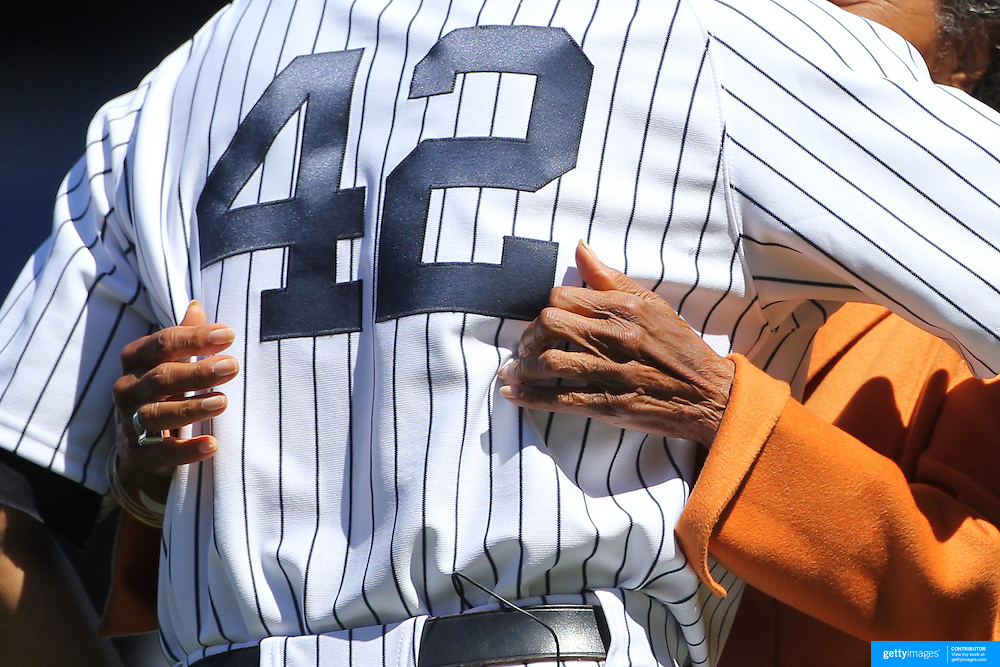 Mariano Rivera, wearing number 42, is embraced by the hands of Rachel Robinson, widow of Jackie Robinson, during Mariano Rivera Day at Yankee Stadium.<br />
