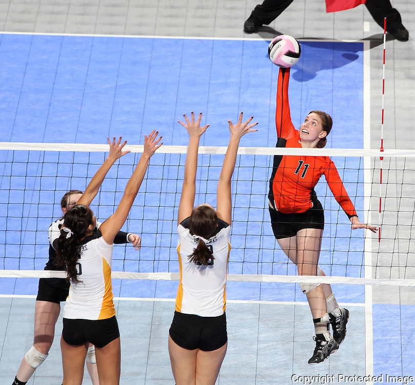 West Delaware's Jessica McDonald (11) goes for a kill over the blocks of Waverly-Shell Rock's Rachel Peth (6) and Ali Ingersoll (13) during the fifth game of a 3A semifinal in the state volleyball tournament at the U.S. Cellular Center at 370 1st Ave E on Friday afternoon, November 12, 2010. (Stephen Mally/Freelance)