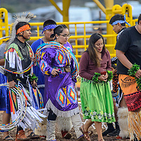 Dancers make their way into the Dean C. Jackson arena before the the Miss Navajo coronation at the Navajo Nation Fairgrounds in Window Rock Saturday.