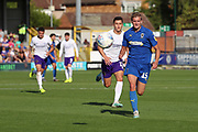 AFC Wimbledon attacker Marcus Forss (15) chasing through ball during the EFL Sky Bet League 1 match between AFC Wimbledon and Shrewsbury Town at the Cherry Red Records Stadium, Kingston, England on 14 September 2019.