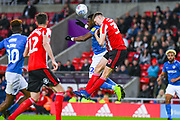 Jimmy Dunne of Sunderland (30) and Omar Bogle of Portsmouth (22) in action during the EFL Sky Bet League 1 first leg Play Off match between Sunderland and Portsmouth at the Stadium Of Light, Sunderland, England on 11 May 2019.