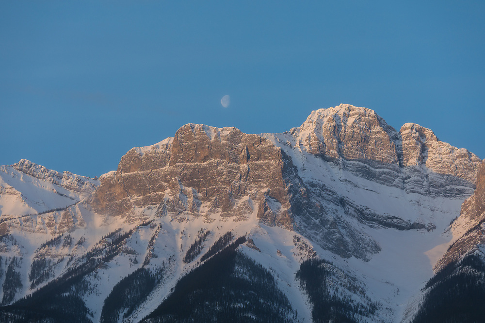 Lawrence Grassi high above Canmore in the early light of the day 5 April, 2018