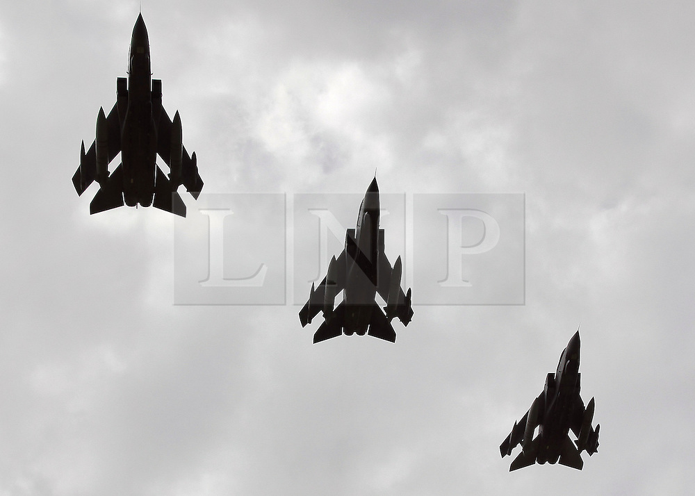 © under license to London News Pictures. 08/04/11 Prime Minister David Cameron is to look again at cuts to the defence budget. According to the reports, plans to scrap RAF Tornados and surveillance planes may be reversed. FILE PICTURE DATED 03/06/09. - a flight of three RAF Tornados fly in formation over RAF Marham in Norfolk. Credit should read Matt Cetti-Roberts/LNP