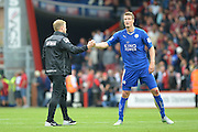 Bournemouth Manager Eddie Howe and Leicester City's Robert Huth during the Barclays Premier League match between Bournemouth and Leicester City at the Goldsands Stadium, Bournemouth, England on 29 August 2015. Photo by Mark Davies.