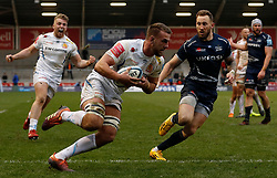 Exeter Chiefs' Sean Lonsdale (centre) runs in his teams third try as Sale Sharks Byron McGuigan (right) watches during the Gallagher Premiership match at the AJ Bell Stadium, Salford.