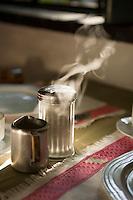 Steaming milk at the breakfast tablwe, Rancho Grande Hotel, Panajachel, Guatemala.