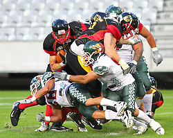08.07.2011, Tivoli Stadion, Innsbruck, AUT, American Football WM 2011, Group A, Germany (GER) vs Mexico (MEX), im Bild Felix Brenner (Germany, #29, WR) get stuck in a group of german and mexican players // during the American Football World Championship 2011 Group A game, Germany vs Mexico, at Tivoli Stadion, Innsbruck, 2011-07-08, EXPA Pictures © 2011, PhotoCredit: EXPA/ T. Haumer