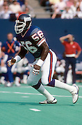 New York Giants linebacker Lawrence Taylor (56) moves towards the play during the NFL football game between the Los Angeles Rams and the New York Giants on September 22, 1985 in East Rutherford, New Jersey. The Giants won the game 27-17. ©Paul Anthony Spinelli