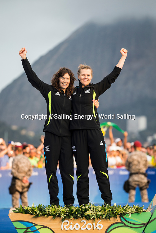 Jo Aleh and Polly Powrie of New Zealand celebrate winning Silver in the 470W class.<br /> The Rio 2016 Olympic Sailing Competition features 380 athletes from 66 nations, in 274 boats racing across ten Olympic disciplines. Racing runs from Monday 8 August through to Thursday 18 August 2016 with 217 male and 163 female sailors racing out of Marina da Gloria in Rio de Janeiro, Brazil. Sailing made its Olympic debut in 1900 and has been a mainstay at every Olympic Games since 1908. For more information or requests please contact Daniel Smith at World Sailing on marketing@sailing.org or phone +44 (0) 7771 542 131.
