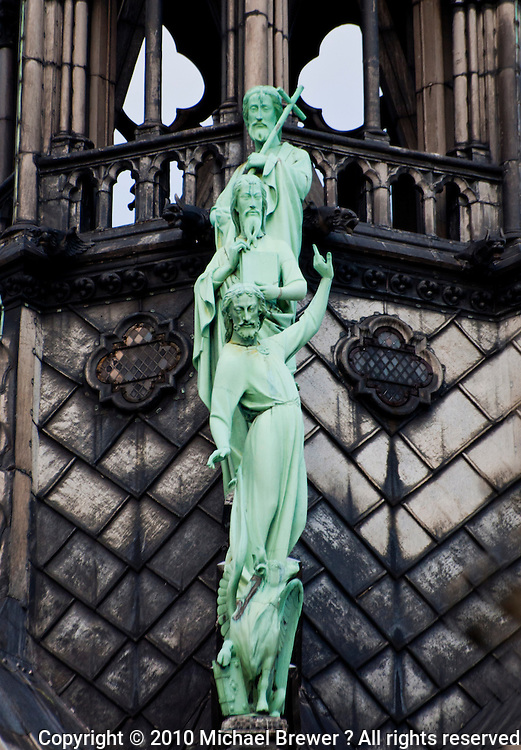 Green statues of Jesus at the Notre Dame cathedral, Paris