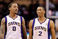 Apr 7, 2013; Phoenix, AZ, USA; Phoenix Suns forward Michael Beasley (0) and forward Wesley Johnson (2) walk up the court during the game against the New Orleans Hornets in the first half at US Airways Center. Mandatory Credit: Jennifer Stewart-USA TODAY Sports