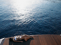 Woman Sunbathing on Yacht