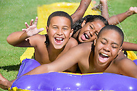 """Friends Sliding on """"Slip 'N Slide"""""""