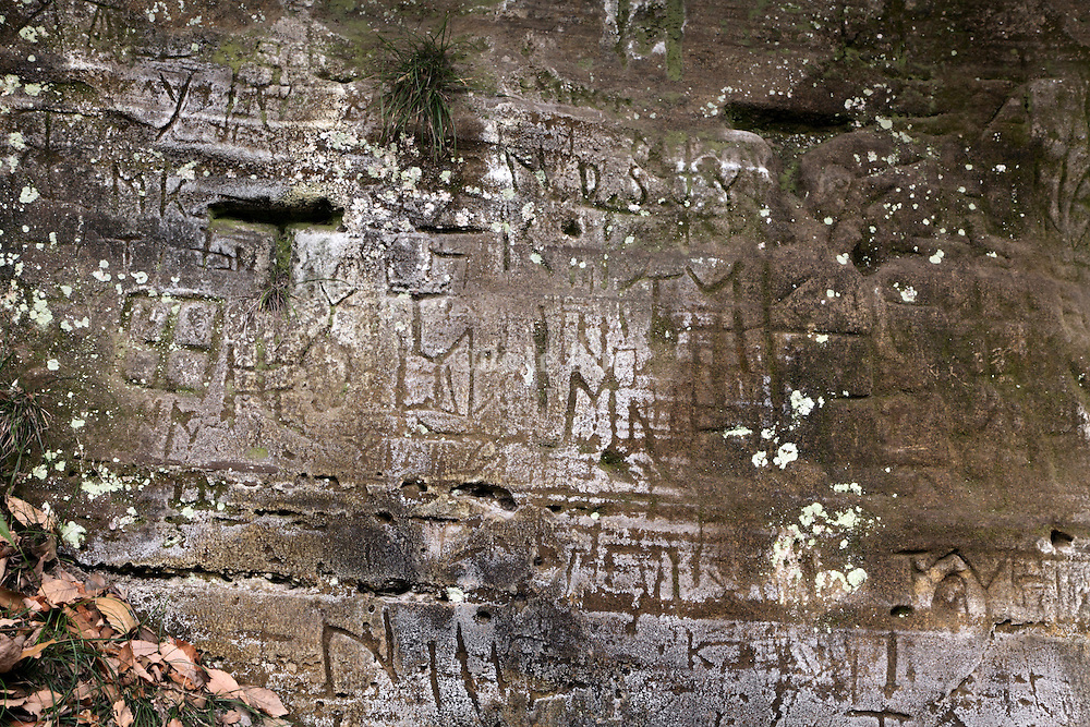 old weathered carved lettering on rock
