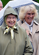 © Licensed to London News Pictures. 10/05/2013. Windsor, UK  Camilla, Duchess of Cornwall HRH Queen Elizabeth II laugh whilst they watche horses in the show. The Royal Windsor Horse Show, set in the grounds of Windsor Castle. Established in 1943, this year will see the Show celebrate its 70th anniversary. Photo credit : Stephen Simpson/LNP