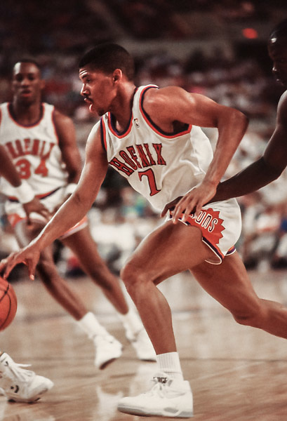PHOENIX - 1990:  Kevin Johnson #7 of the Phoenix Suns dribbles the ball during an NBA game against the Utah Jazz played in 1990 at the Arizona Veterans Memorial Coliseum in Phoenix, Arizona. (Photo by David Madison/Getty Images) *** Local Caption *** Kevin Johnson