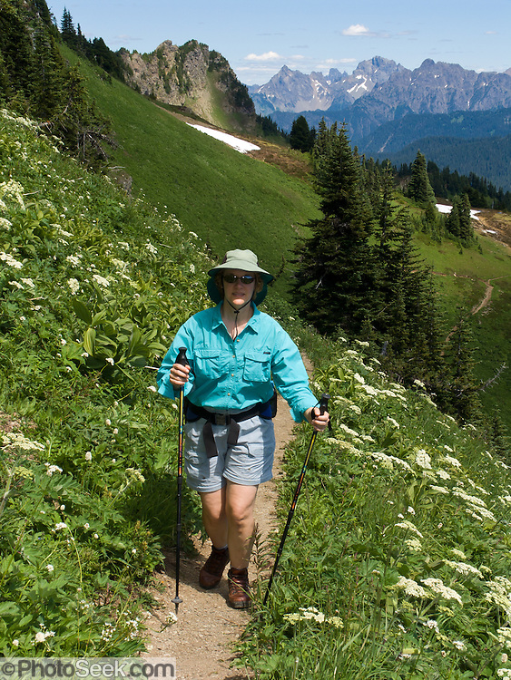 A woman hikes the Church Mountain trail in Mount Baker - Snoqualmie National Forest, North Cascade mountain range, Washington, USA. For licensing options, please inquire.