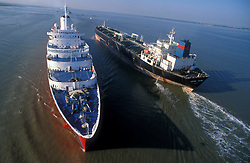 Aerial view of two large ocean liners passing