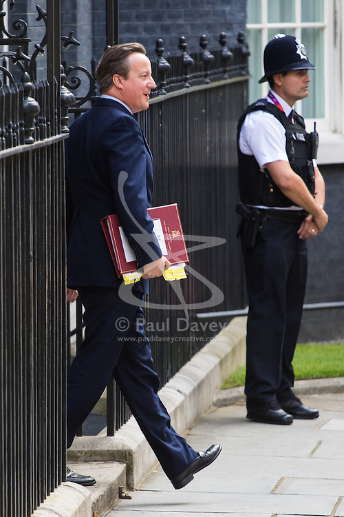 Downing Street, London, July 13th 2016. British Prime Minister David Cameron leaves 10 Downing Street on his way to the House of Commons for Prime Minister's Questions, his last before handing over to Theresa May, the country's new Prime Minister.
