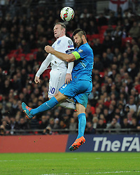 Caption Correction * Wayne Rooney of England (Manchester United) battles for a high ball with Bostjan Cesar of Slovenia   - Photo mandatory by-line: Alex James/JMP - Mobile: 07966 386802 - 15/11/2014 - SPORT - Football - London - Wembley - England v Slovenia - EURO 2016 Qualifier