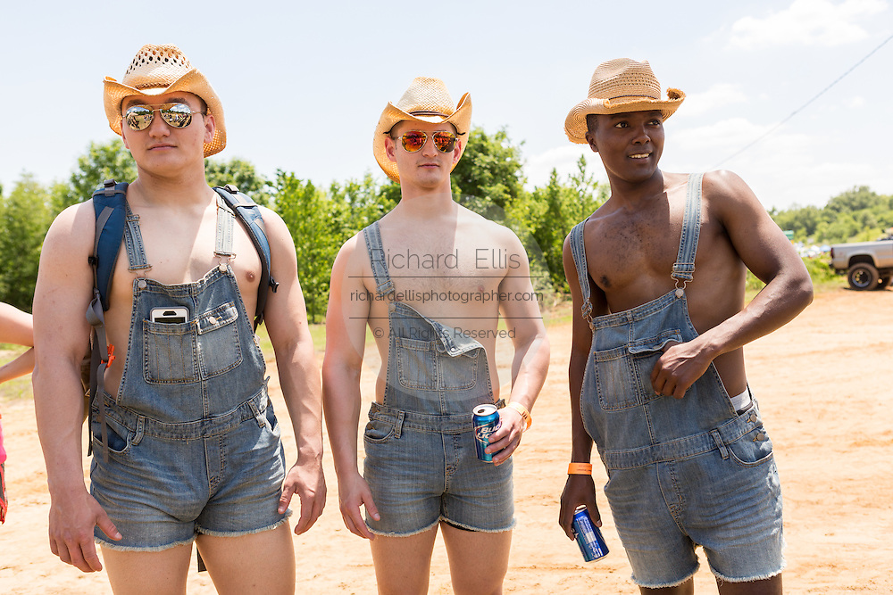 A group of men dressed in red neck finery during the 2015 National Red Neck Championships May 2, 2015 in Augusta, Georgia. Hundreds of people joined in a day of country sport and activities.