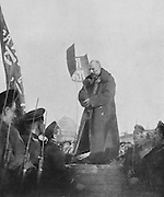 Nikolay Chkheidze, 1864-1926, Georgian Social Democrat politician and president of the Executive Committee of the Soviet of Petrograd, making a speech to riflemen at a barracks during the Russian Revolution, photograph published on the front page of L'Illustration, no.3871, 12th May 1917. Chkheidze was Chairman of the Executive Committee of Workers and Soldiers, leader of the Workers' Party and of the opposition to the Provisional Government. Picture by Manuel Cohen