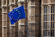On the day that Prime Minister Theresa May returns to Brussels to negotiate an expected Brexit delay, the EU flag flies as pro-EU remainers protest outside Westminster Abbey opposite parliament in Westminster, in London, England.
