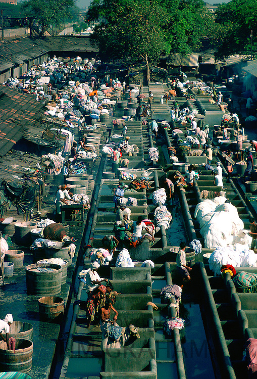 People at work at open air laundry, Bombay, India