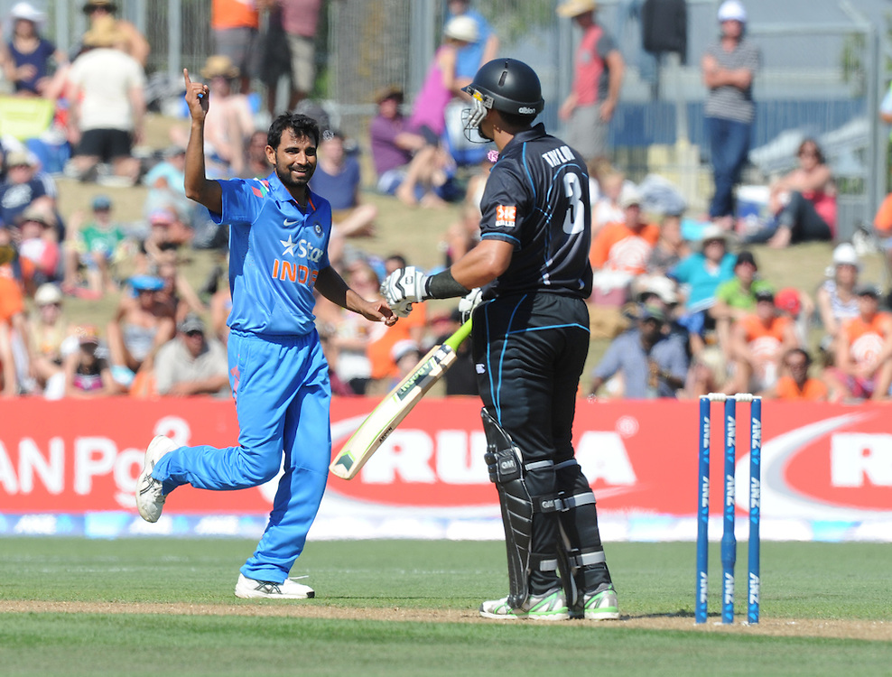 India's Mohammed Shami, left, celebrates after dismissing New Zealand's Ross Taylor for 52 in the first one day International cricket match, McLean Park, New Zealand, Sunday, January 19, 2014. Credit:SNPA / Ross Setford