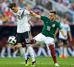 MOSCOW, RUSSIA - Sunday, June 17, 2018: Germany's Mesut Oezil (left) and Mexico's Hector Herrera (right) during the FIFA World Cup Russia 2018 Group F match between Germany and Mexico at the Luzhniki Stadium. (Pic by David Rawcliffe/Propaganda)