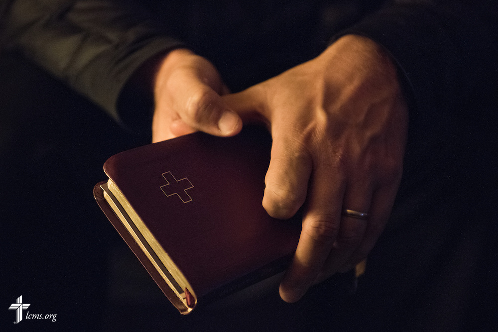 The Rev. Adam DeGroot, new national missionary and pastor at Shepherd of the City Lutheran Church, prepares to read Holy Scripture during a home visit on Monday, Nov. 2, 2015, in Philadelphia.  LCMS Communications/Erik M. Lunsford