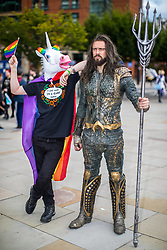"© Licensed to London News Pictures . 30/07/2017 . Manchester , UK . "" The Gay Unicorn "" (Joseph Jones, 18 from West Yorkshire) with New Aquaman (Robin Yardley (31 from Worcestershire) . Cosplayers, families and guests at Comic Con at the Manchester Central Convention Centre . Photo credit : Joel Goodman/LNP"