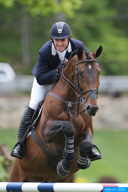 Quentin Judge riding HH Copin Van De Broy in action during the $35,000 Grand Prix of North Salem presented by Karina Brez Jewelry during the Old Salem Farm Spring Horse Show, North Salem, New York, USA. 15th May 2015. Photo Tim Clayton