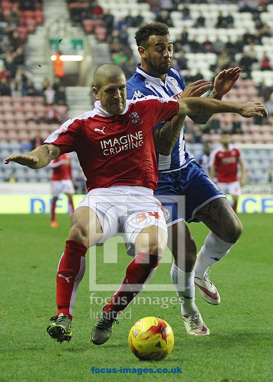 Craig Davies of Wigan Athletic and Adam El-Abd of Swindon Town in action during the Sky Bet League 1 match at the DW Stadium, Wigan.<br /> Picture by Michael Sedgwick/Focus Images Ltd +44 7900 363072<br /> 31/10/2015