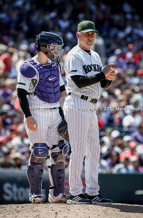 SHOT 5/28/17 1:49:23 PM - Colorado Rockies manager Bud Black #10 waits for a relief pitcher on the mound with catcher Tony Wolters #14 against the St. Louis Cardinals  during their regular season MLB game at Coors Field in Denver, Co. The Rockies won the game 8-4. (Photo by Marc Piscotty / © 2017)