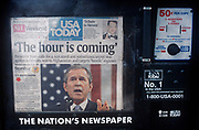 A week after the 9-11 terrorist attacks on the Twin Towers and the Pentagon, the headline on the front page of the USA Today newspaper runs a quote from President George W Bush - 'The Hour is Coming' - a message of imminent reprisals against al Qaeda terrorists and the followers in Afghanistan of the Saudi-born Osama bin Laden, on 21st September 2001, New York, USA. (Photo by Richard Baker / In Pictures via Getty Images)