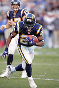 SAN DIEGO - JANUARY 14:  Running back LaDainian Tomlinson #21 of the San Diego Chargers scores a touchdown on a 3 yard run in the fourth quarter for a 21-13 lead over the New England Patriots at the AFC Divisional Playoff Game held on January 14, 2007 at Qualcomm Stadium in San Diego, California. The Patriots defeated the Chargers 24-21. ©Paul Anthony Spinelli *** Local Caption *** LaDainian Tomlinson