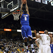 Memphis forward Will Coleman (0) slams the ball during a Conference USA NCAA basketball game between the Memphis Tigers and the Central Florida Knights at the UCF Arena on February 9, 2011 in Orlando, Florida. Memphis won the game 63-62. (AP Photo: Alex Menendez)