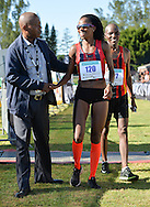 EAST LONDON, SOUTH AFRICA - FEBRUARY 20: Mapaseka Makhanya of Central Gauteng Athletics (CGA) finishes second and is congratulated by ASA board member, James Moloi, during the ASA Marathon Championships in East London on February 20, 2015 in South Africa. (Photo by Roger Sedres/Gallo Images)