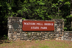 Entrance sign to Watson Mill Bridge State Park near Carlton, Georgia.  The park is home to the longest original-site covered bridge in Georgia, which spans 229 feet across the South Fork River. The bridge, being more than 100 years old, is supported by a town lattice truss system held firmly together with wooden pins.