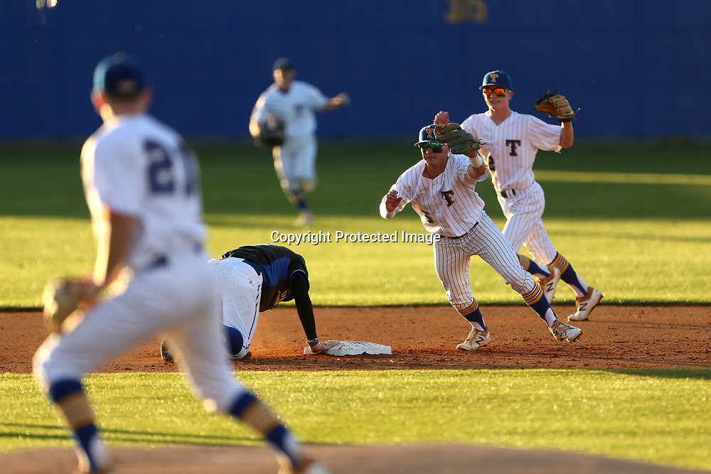 Tupelo shortstop Stephen Matthews celebrates after getting the third out against Warren Central as Vantrel Reed tried to dive back to second base in the top of the first inning.